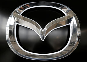 A Mazda logo is seen at a showroom of a dealership in Merignac, near Bordeaux, France, April 8, 2019. REUTERS/Regis Duvignau