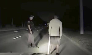 In this Monday, May 29, 2017 still image taken from video provided by the Jupiter Police Department Tiger Woods steps off line during a field sobriety test after he was found sound asleep behind the wheel of his car partially on the road in Jupiter, Fla. Woods was arrested on suspicion of driving under the influence. Woods issued a statement nearly 10 hours after he was released from jail on Monday that alcohol was not involved. (Jupiter Police Department via AP)