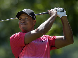 Tiger Woods tees off on the 5th hole during the final round of the Quicken Loans National Golf Tournament at the Robert Trent Jones Golf Club on Sunday, August 2, 2015.  (Photo by Toni L. Sandys/ The Washington Post via Getty Images)
