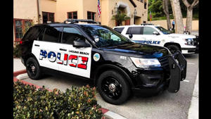 a police car parked on the side of a road: Laguna Beach Police Cruiser