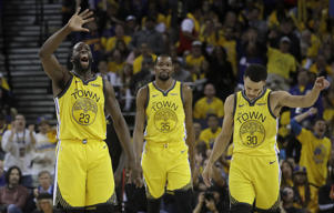 Golden State Warriors forward Draymond Green (23), forward Kevin Durant (35) and guard Stephen Curry (30) react after Los Angeles Clippers guard Patrick Beverley fouled out during the second half of Game 2 of a first-round NBA basketball playoff series in Oakland, Calif., Monday, April 15, 2019. (AP Photo/Jeff Chiu)