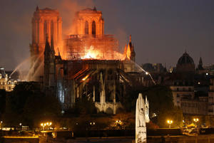 PARIS, FRANCE - APRIL 15: Flames and smoke are seen billowing from the roof at Notre-Dame Cathedral on April 15, 2019 in Paris, France. A fire broke out on Monday afternoon and quickly spread across the building, collapsing the spire.  (Photo by Chesnot/Getty Images)