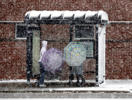 Pedestrians wait for a bus at a bus stop during a snow day, Sunday, April 14, 2019, in Chicago. A late season storm is bring heavy wet snow to the Chicago area today. Temperatures have dropped to near freezing in many locations.(AP Photo/Nam Y. Huh)