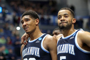 CAPTION: HARTFORD, CONNECTICUT - MARCH 23: Jermaine Samuels #23 and Phil Booth #5 of the Villanova Wildcats reacts after their teams loss to the Purdue Boilermakers during the second round of the 2019 NCAA Men's Basketball Tournament at XL Center on March 23, 2019 in Hartford, Connecticut.