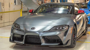 a car parked on the side of a building: 2020 Toyota Supra production start