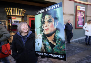 "Brenda Jenkyns who drove from Calgary, Canada stands with a sign outside of the premiere of the ""Leaving Neverland"" Michael Jackson documentary film at the Egyptian Theatre on Main Street during the 2019 Sundance Film Festival, Friday, Jan. 25, 2019, in Park City, Utah. (Photo by Danny Moloshok/Invision/AP)"