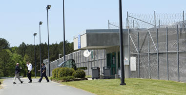 Prison officials enter and exit Lanesboro Correctional Institution in Polkton, N.C. At least eight Lanesboro employees were caught bringing in drugs, cellphones and tobacco from early 2013 to early 2017. (John D. Simmons/Charlotte Observer/TNS via Getty Images)