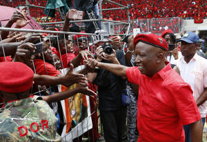 Economic Freedom Fighters (EFF) leader Julius Malema greets his supporters as he arrives for the party's 2019 Election Manifesto Launch at the Giant Stadium in Pretoria on February 2, 2019.