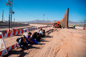 Salvadoran migrants wait for a transport to arrive after turning themselves into US Border Patrol by border fence under construction in El Paso, Texas on March 19, 2019. - Speaking of an 'invasion' of illegal immigrants and criminals, US President Donald Trump last week signed the first veto of his presidency, overriding congressional opposition to secure emergency funding to build a wall on the Mexican border, the signature policy of his administration. (Photo by Paul RATJE / AFP)        (Photo credit should read PAUL RATJE/AFP/Getty Images)