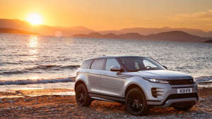 a car parked in front of a body of water: 2020 Land Rover Range Rover Evoque