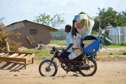 A couple leave on a motorbike as they flee from the area of previous fighting in the Jabel area of Juba, South Sudan, Saturday, July 16 2016. Some South Sudanese, even those with dual U.S. citizenship, are not being allowed to leave the country, even as the United States, India and other countries continued Thursday to evacuate their citizens while a fragile cease-fire appeared to hold (AP Photo/SamirBol)