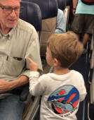 Three-year-old future politician introduces himself to plane passengers