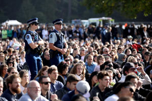 Police patrol during the National Remembrance Service at North Hagley Park in Christchurch on March 29, 2019.