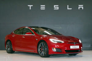 The Tesla Model S P100D being introduced at an event in Gimpo, Gyeonggi Province, South Korea on 26 February 2018. The person in image is unidentified.