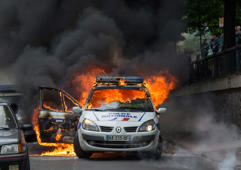 PARIS, FRANCE - MAY 18:  A police car burns during a demonstration against police brutality on May 18, 2016 in Paris, France. Around 200 people demonstrated against police brutality, despite the demonstration being forbidden by the police department.  (Photo by Aurelien Meunier/Getty Images)
