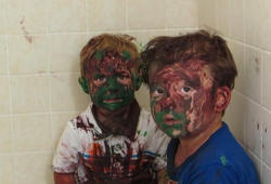 Adorable kids caught after painting disaster