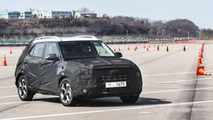 a car parked in a parking lot: 2020 Hyundai Venue Prototype: First Drive