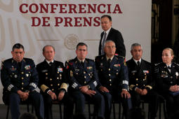 Public Safety Secretary Alfonso Durazo walks behind a row of generals attending the daily press briefing at the National Palace in Mexico City, Friday, April 12, 2019.  Mexico's newly formed National Guard ultimately will be under the civilian authority Durazo. (AP Photo/Marco Ugarte)