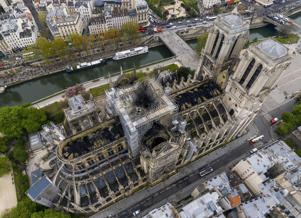 An image made available by Gigarama.ru on Wednesday April 17, 2019 shows an aerial shot of the fire damage to Notre Dame cathedral in Paris on Tuesday April 16. Nearly $1 billion has already poured in from ordinary worshippers and high-powered magnates around the world to restore Notre Dame Cathedral in Paris after it was damaged in a massive fire on Monday.