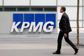 The logo of KPMG, a professional service company, is seen at the company's head offices at La Defense business and financial district in Courbevoie near Paris, France. May 16, 2018.  REUTERS/Charles Platiau
