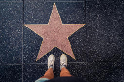 Hollywood, California, USA- October 12, 2016: Tourist photographing her with an empty star on the Walk of Fame in Hollywood. Hollywood Walk of Fame features more than 2,500 stars with inscribed celebrity names.