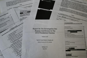 An illustration shows printed pages of the redacted Mueller Report at an office on April 18, 2019, in Washington, DC. - US Attorney General Bill Barr said Thursday that the White House fully cooperated with Special Counsel Robert Mueller's probe of Russian election meddling and that President Donald Trump took no action to thwart the probe. 'There is substantial evidence to show that the president was frustrated and angered by a sincere belief that the investigation was undermining his presidency, propelled by his political opponents, and fueled by illegal leaks,' Barr said ahead of the release of the Mueller report. (Photo by Eva HAMBACH / AFP)        (Photo credit should read EVA HAMBACH/AFP/Getty Images)