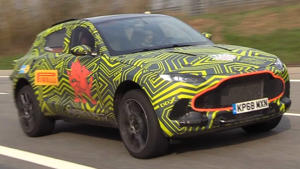 a car parked on the side of a road: Aston Martin DBX at the Nurburgring