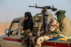 AGADEZ, NIGER - OCTOBER 8: Armed soldiers of the Niger National Guard protect a convoy crossing the Sahara Desert from Niger north to Libya, often with Nigerien workers on overloaded trucks destined for work in mines, on October 8, 2018 in Agadez, Niger. Aside from civilian convoys, National Guard patrols hunt armed Islamists in this Sahel region half the size of Texas. In a bid to stem irregular migration from Africa to Europe, the EU is spending $270 million on an 'Emergency Trust Fund' for programs in Niger, part of a security-development package that has seen the number of migrants heading north drop from 334,000 in 2016 to fewer than 50,000 in 2018. (Photo by Scott Peterson/Getty Images)