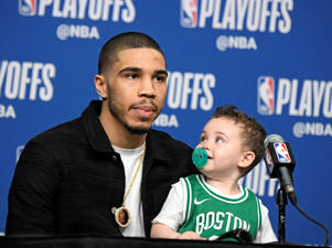 Jayson Tatum #0 of the Boston Celtics talks to the media with his son following Game Two of Round One of the 2019 NBA Playoffs against the Boston Celtics on April 17, 2019 at the TD Garden in Boston, Massachusetts. NOTE TO USER: User expressly acknowledges and agrees that, by downloading and or using this photograph, User is consenting to the terms and conditions of the Getty Images License Agreement. Mandatory Copyright Notice: Copyright 2019 NBAE (Photo by Brian Babineau/NBAE via Getty Images)