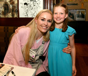 NASHVILLE, TN - APRIL 16: US Olympian Lindsey Vonn and make-a-wish child take photos during Waiting for Wishes Celebrity Waiters Dinner hosted by Kevin Carter & Jay DeMarcus on April 16, 2019 in Nashville, Tennessee.  (Photo by Jason Davis/Getty Images for LEGACY Events)