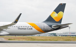 The tail section of an Airbus A321 of the airline Condor features the new design of travel company Thomas Cook at the airport in Frankfurt am Main, Germany, 27 May 2015. Photo:Christoph Schmidt/dpa | usage worldwide   (Photo by Christoph Schmidt/picture alliance via Getty Images)