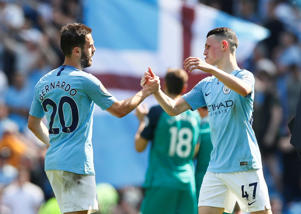 "Soccer Football - Premier League - Manchester City v Tottenham Hotspur - Etihad Stadium, Manchester, Britain - April 20, 2019  Manchester City's Phil Foden and Bernardo Silva celebrate after the match          Action Images via Reuters/Jason Cairnduff  EDITORIAL USE ONLY. No use with unauthorized audio, video, data, fixture lists, club/league logos or ""live"" services. Online in-match use limited to 75 images, no video emulation. No use in betting, games or single club/league/player publications.  Please contact your account representative for further details."
