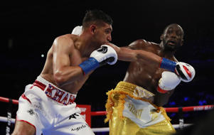 Boxing - Terence Crawford v Amir Khan - WBO World Welterweight Title - Madison Square Garden, New York, U.S. - April 20, 2019. Terence Crawford and Amir Khan in action. Action Images via Reuters/Andrew Couldridge