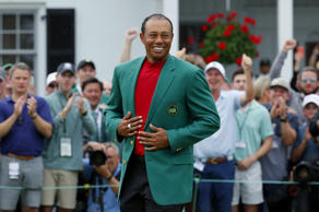 Tiger Woods wears  the green jacket as he celebrates after winning the 2019 Masters