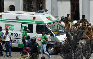 An ambulance is seen outside the church premises with gathered security personnel
