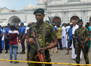 Security personnel stand guard near a Church