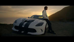 a man standing on top of a hill: The Fate of the Furious: The Album available now - https://atlantic.lnk.to/f8  Download the new Furious 7 Soundtrack Deluxe Version on iTunes here: http://smarturl.it/furious7deluxe  See Wiz on tour http://wizkhalifa.com/tour  Tag ‪#‎SeeYouAgain‬ on Shazam and get an exclusive behind the scenes look at the music video!  Get official merch here: http://atlr.ec/OfficialWKMerchYT  Stream Furious 7 on Spotify: http://smarturl.it/streamFurious7  Directed by: Marc Klasfeld  Follow Wiz: ►Subscribe to channel: http://goo.gl/y3Bnno ►Twitter - https://twitter.com/wizkhalifa ►Facebook - https://facebook.com/wizkhalifa ►Instagram - https://instagram.com/mistercap ►Soundcloud - https://soundcloud.com/wizkhalifa ►Website: http://wizkhalifa.com ►Taylor Gang: http://taylorgang.com  Follow Charlie Puth: ►Subscribe to channel: https://www.youtube.com/charlieputh ►Twitter - https://twitter.com/charlieputh ►Facebook - https://www.facebook.com/charlieputh ►Instagram - http://instagram.com/charlieputh ►Soundcloud - https://soundcloud.com/charlieputh ►Website: http://charlieputh.com/  Wiz Khalifa - See You Again ft. Charlie Puth [Official Video] Furious 7 Soundtrack