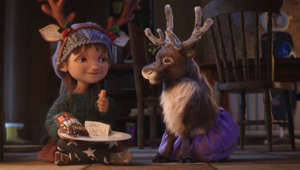 a small child sitting on a table: McDonald's releases 'Reindeer Ready' Christmas advert