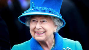 a close up of a smiling boy wearing a blue hat: Queen Elizabeth II's record-breaking 63-year reign