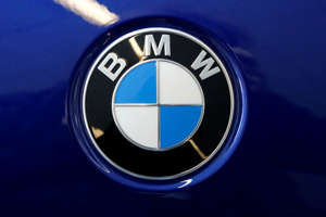 This is a BMW logo on a BMW automobile on display at the Pittsburgh Auto Show Thursday, Feb. 15, 2018. (AP Photo/Gene J. Puskar)