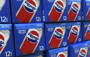 In this Monday, April 23, 2018, photo, Pepsi soft drink cases are stacked on display at a store in Londonderry, N.H. PepsiCo Inc. reports earns on Thursday, April 26. (AP Photo/Charles Krupa)