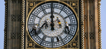 Workmen clean the clock face of St Stephens Tower which houses Big Ben in London.   (Photo by Lewis Whyld - PA Images/PA Images via Getty Images)