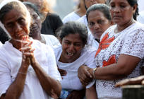 Mother of Shaini, 13, who died during a string of suicide bomb attacks on churches and luxury hotels on Easter Sunday, mourns at her funeral outside St Sebastian's Church in Negombo, Sri Lanka April 24, 2019. REUTERS/Athit Perawongmetha