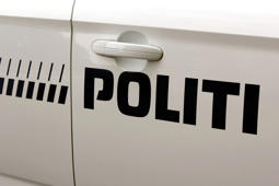 Inscription detail of a police car in Copenhagen, Denmark.