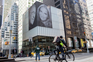 A photo of Macklowe and his new wife, Patricia Landeau, hang outside 432 Park Avenue in New York.