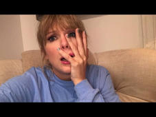a man talking on a cell phone: Music video by Taylor Swift performing ME! (feat. Brendon Urie of Panic! At The Disco). © 2019 Taylor Swift Productions, Inc. All rights Reserved.  http://vevo.ly/Qomy3S