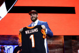 Alabama tackle Jonah Williams poses with his new jersey after the Cincinnati Bengals selected Williams in the first round at the NFL football draft, Thursday, April 25, 2019, in Nashville, Tenn. (AP Photo/Mark Humphrey)