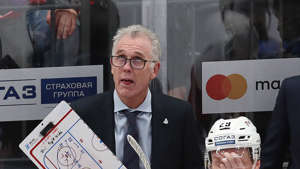 Craig MacTavish wearing a suit and tie: Craig MacTavish at their 2019/2020 KHL Regular Season match against CSKA Moscow, who won 5-2.