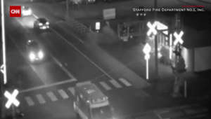 Car explodes in flames at a railroad crossing