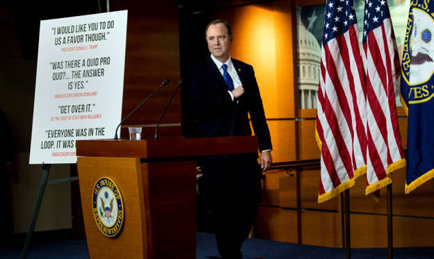 Adam Schiff in a suit standing in front of a store: Representative Adam B. Schiff, the chairman of the Intelligence Committee, led the impeachment inquiry.